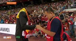 Le caméraman qui a blessé Usain Bolt lui a offert un cadeau (vidéo) 5